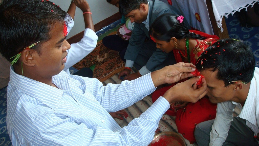 dashain Photo Pictures images while putting Tika on forehead