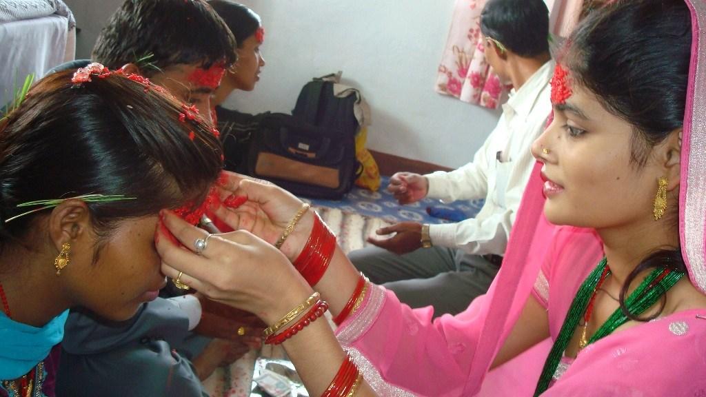 Vijaya dashami dashain Photos Pictures images while putting Tika on forehead