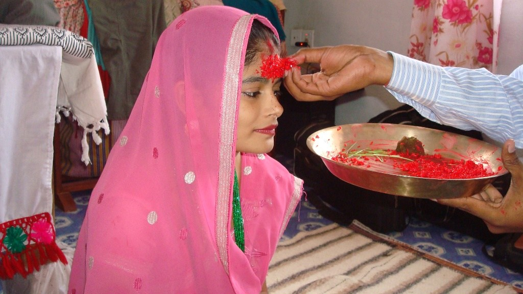 Vijaya dashami dashain Photos Pictures images while putting Tika on forehead