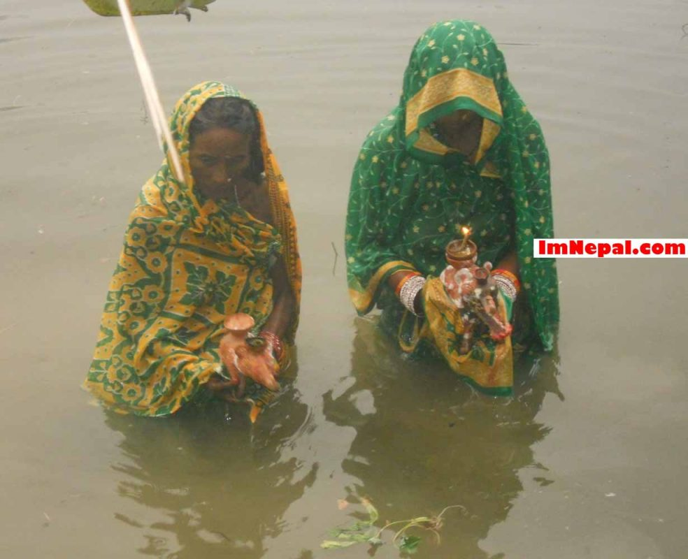 Chhath Puja Devotees in the Water Pond of the Countryside of Nepal