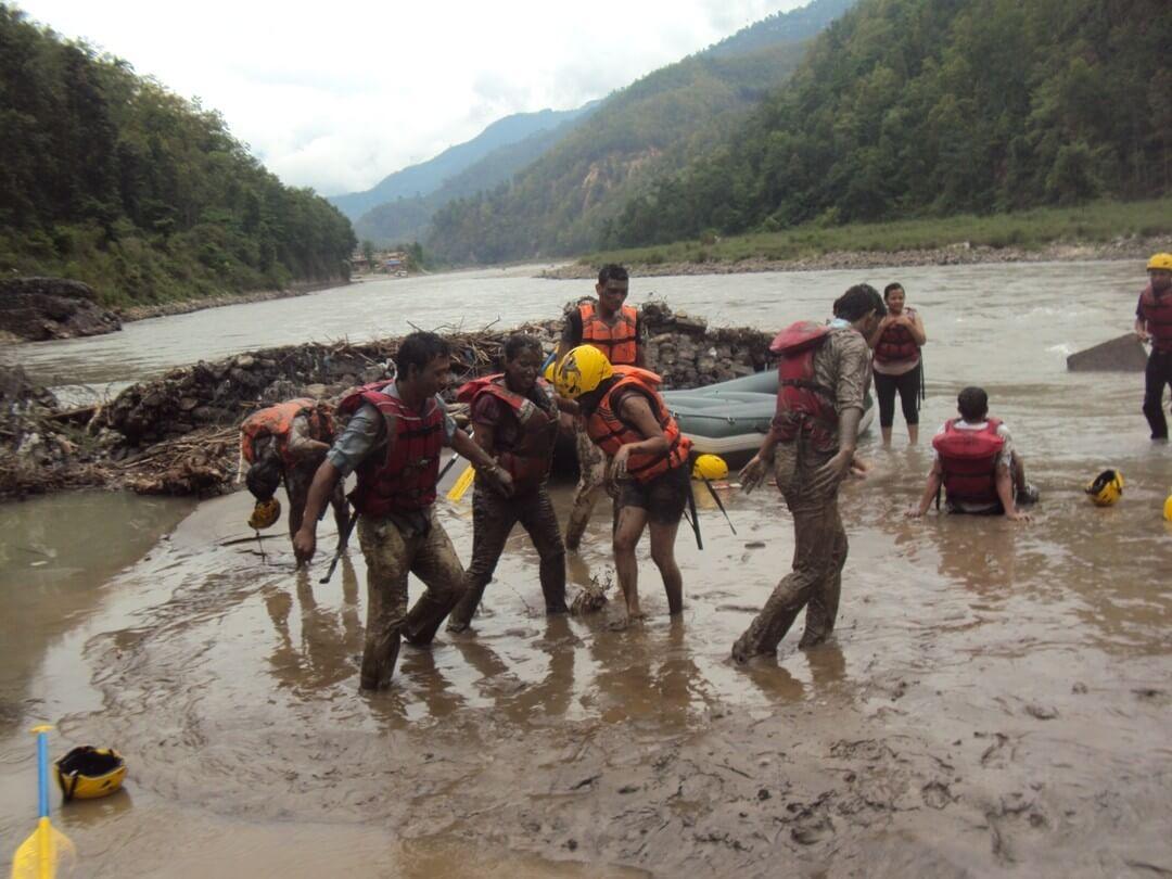 rafting nepal playing tourists mud water image