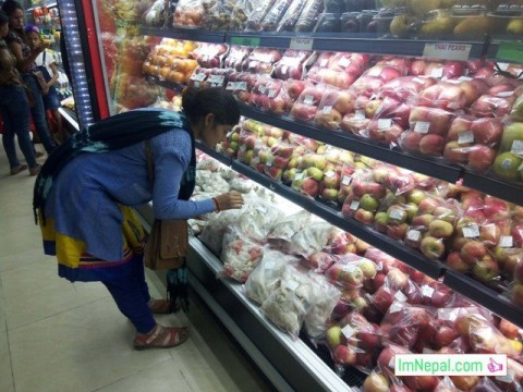 A Lady is seeing some fruits and vegetables in supermarket of Nepal