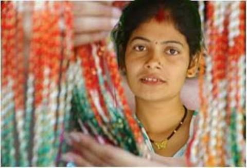 Rakhi Raksha Bandhan Janai Purnima SMS wishes messages Nepali a woman is seeing Rakhi for her brother