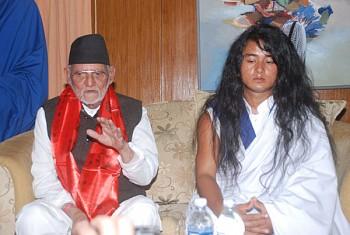 ram bahadur bamjan buddha boy with prime minister shushil koirala