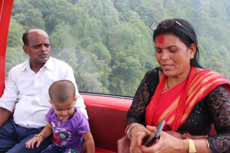 A family in the cable car of Chandragiri Hills Station Kathmandu Nepal Cable car places Travel Visit Outing Destination Pictures