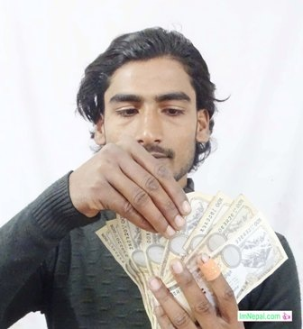 a young man is counting Nepalese rupees money cash