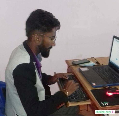 a man working doing research with laptop