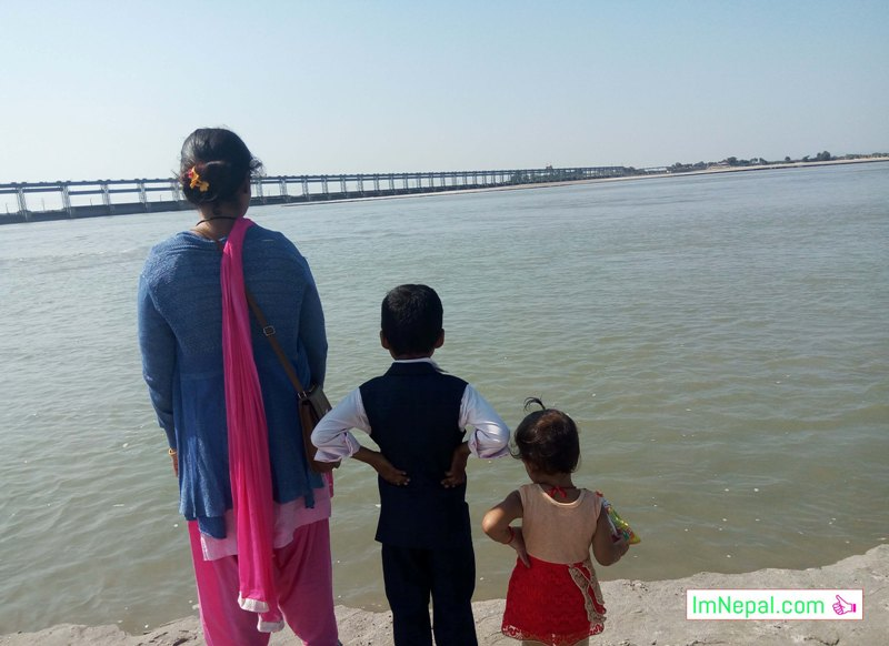 traveller family mother son daughter koshi river seeing beautiful scene