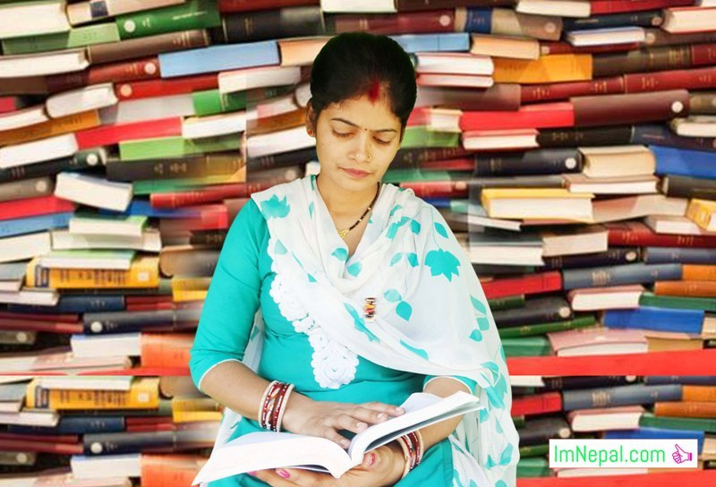 a woman lady girl is studing in library