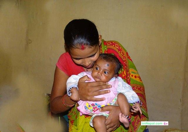 Chaupadi pratha in Nepal - a baby with mother