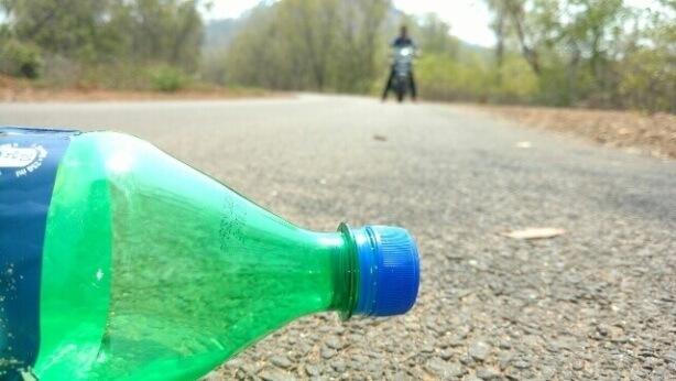 throwing bottles on road