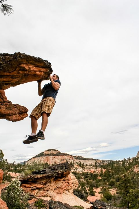 A man climbing mountains picture