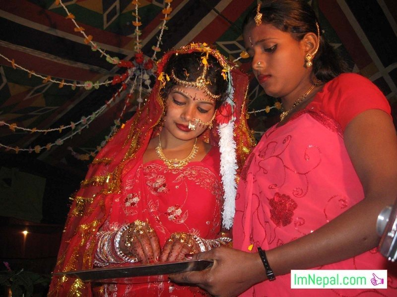 bride is performing a ritual in swayambar stage marriage bibah ceromoney Madhesh Terai Mithila Nepal