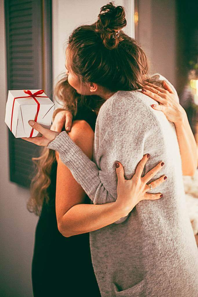 Woman hugging with gifts
