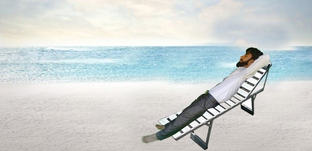 Outing a man is in sea beach with stylish chair