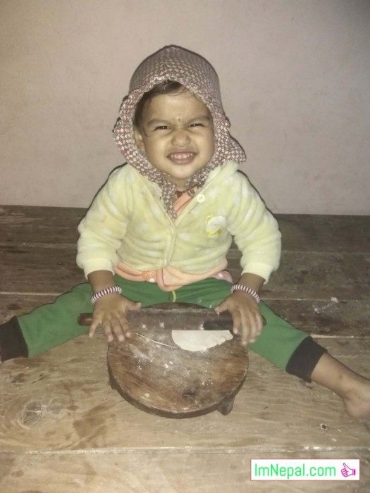 little kid girl is making Roti - playing game fun