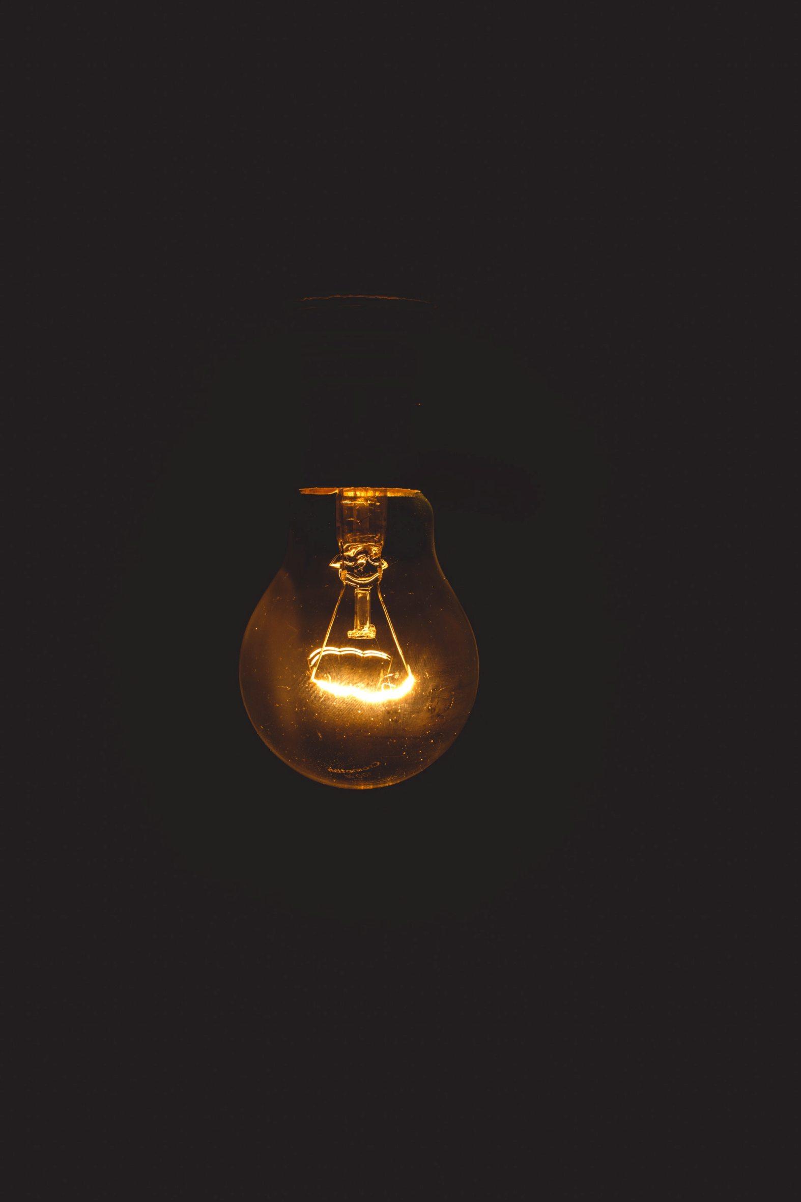 black wallpaper light bulb