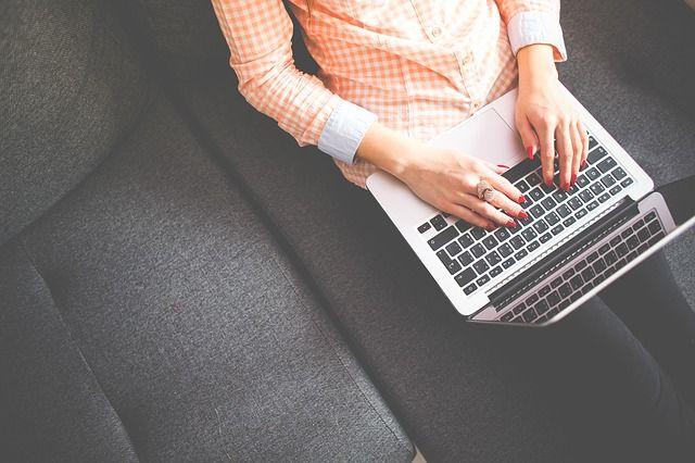 student working blogging laptop